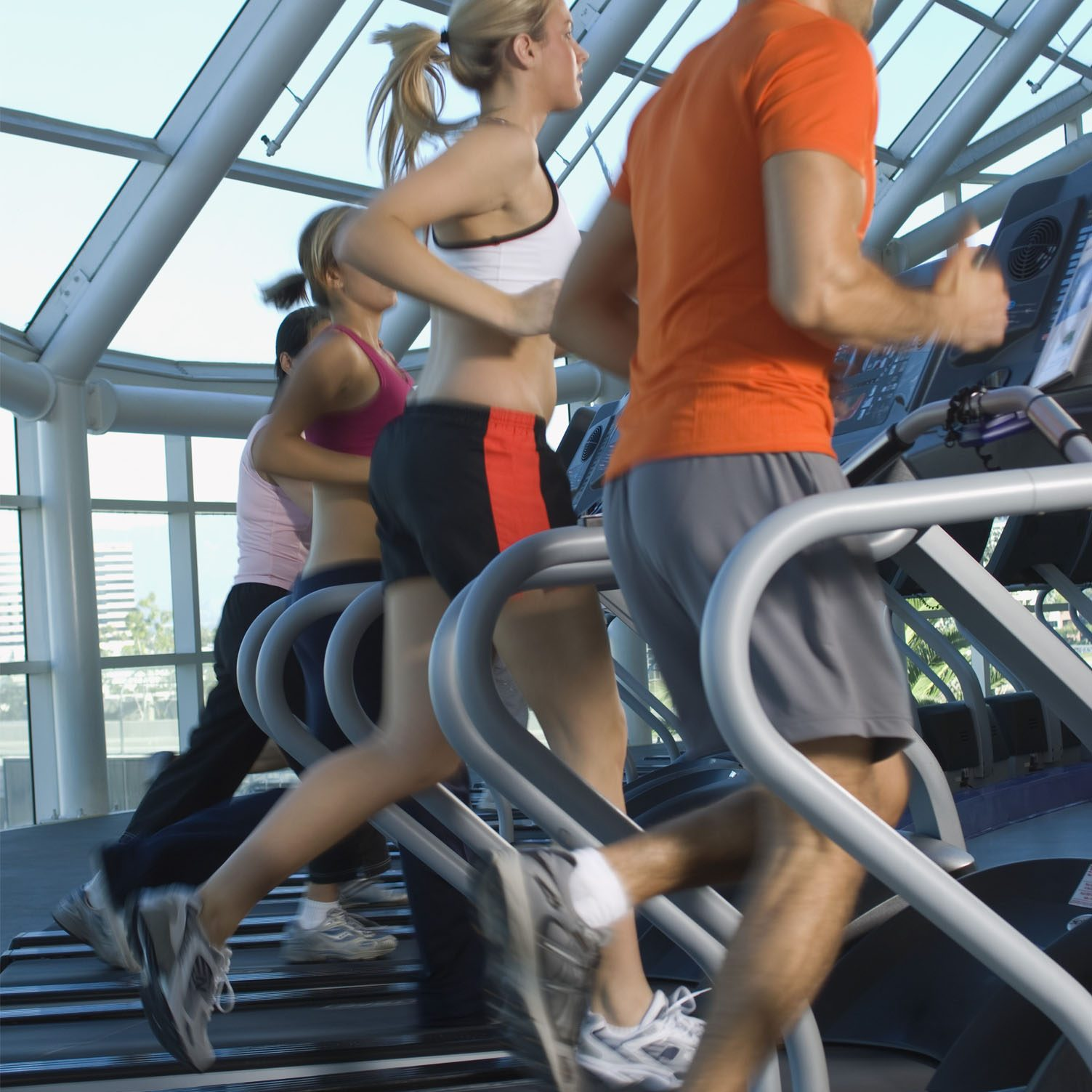 Joggers on Treadmills in Gym